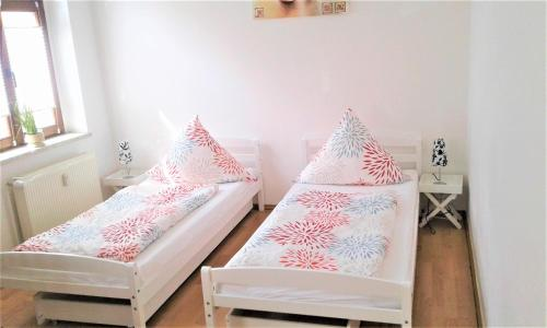 Ein Bett oder Betten in einem Zimmer der Unterkunft Citywohnung am Rannischen Platz