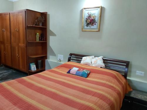 A bed or beds in a room at Tarana Homestay