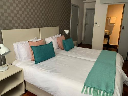 Cama o camas de una habitación en Cape Diamond Boutique Hotel