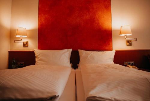 Ein Bett oder Betten in einem Zimmer der Unterkunft Badischer Hof