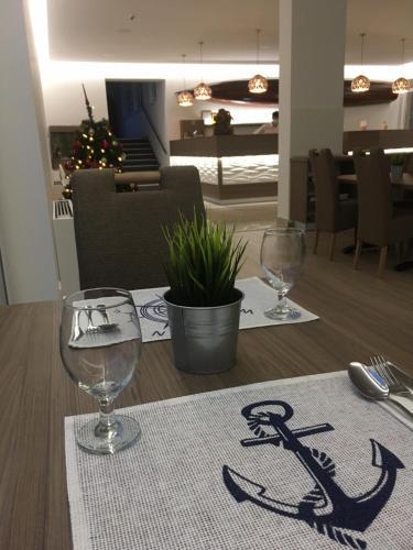 A restaurant or other place to eat at Nautilus Étterem és Panzió