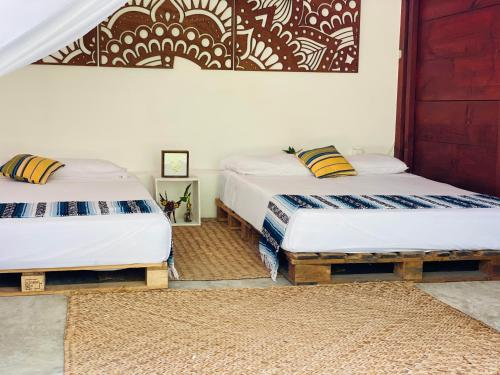 A bed or beds in a room at El Búho Sport Camp