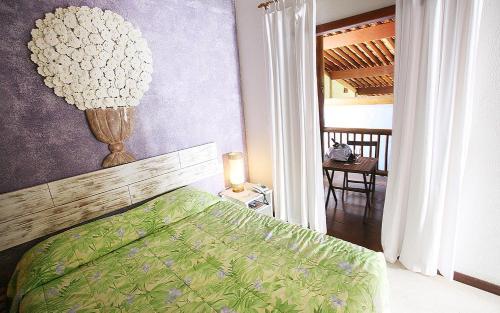 A bed or beds in a room at Pousada Rosa dos Ventos