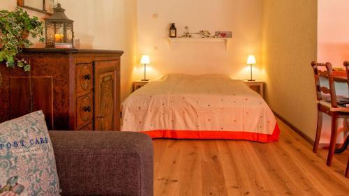 Ein Bett oder Betten in einem Zimmer der Unterkunft Appartamento a Locarno