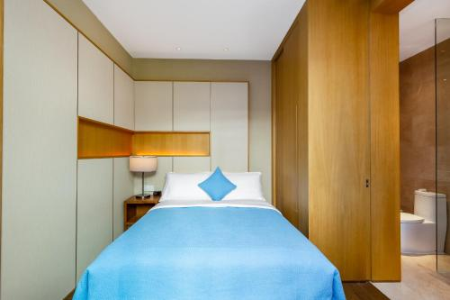A bed or beds in a room at Albion Residence Haitang Bay Sanya