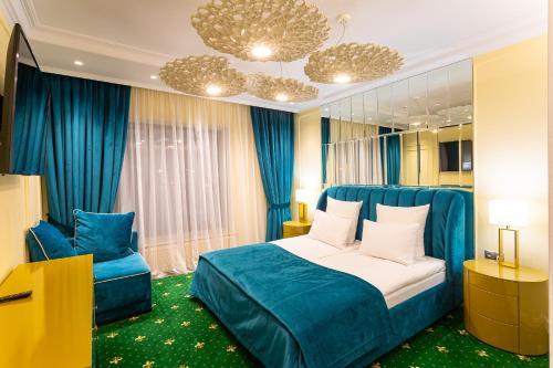 Кровать или кровати в номере Дворец гимнастики Ирины Винер-Усмановой
