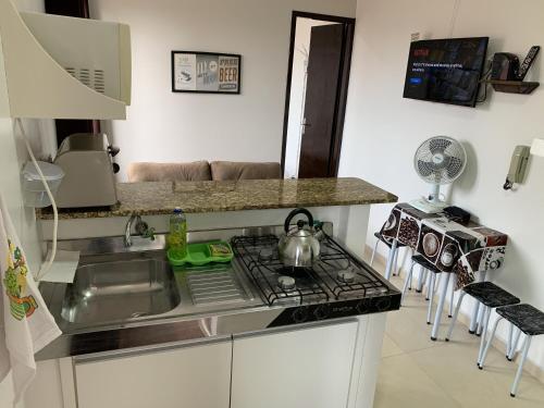 A cozinha ou cozinha compacta de Apartamento Jangada
