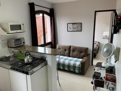 Uma área de estar em Apartamento Jangada