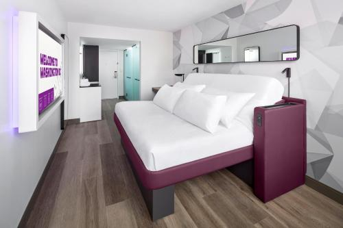 A bed or beds in a room at Yotel Washington DC