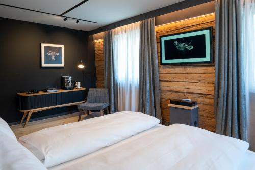 Ein Bett oder Betten in einem Zimmer der Unterkunft Der Löwe