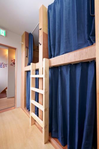 Guesthouse OYADO SAPPORO にある二段ベッド
