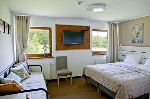 Posteľ alebo postele v izbe v ubytovaní Penzión pod Karpatmi