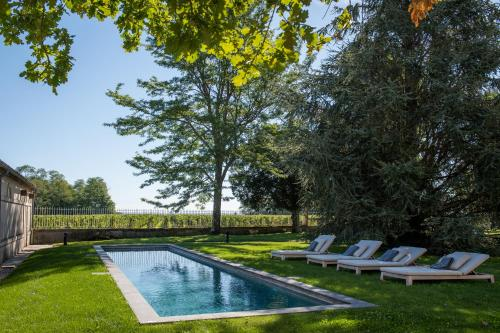 The swimming pool at or near Château Malescasse