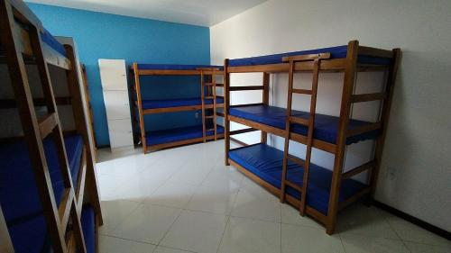 A bunk bed or bunk beds in a room at Enseada Hostel