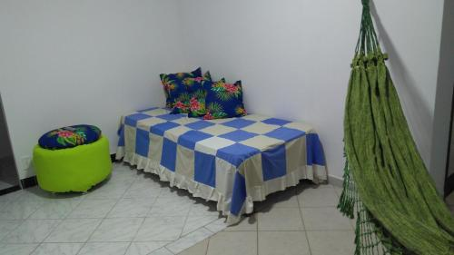 A bed or beds in a room at Casa na praia de Aruana