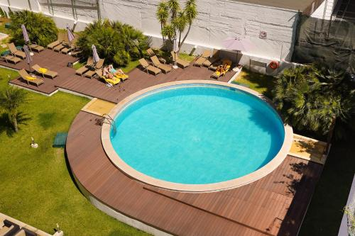 A view of the pool at Legendary Lisboa Suites or nearby