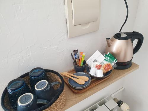 Coffee and tea-making facilities at Chambres d'Hotes - L'Abri sous Roche