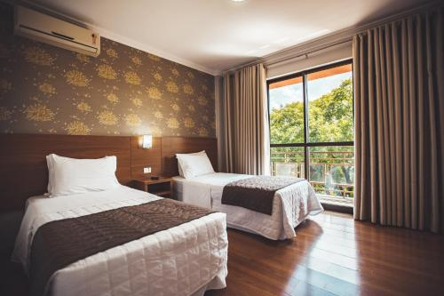 A bed or beds in a room at Hotel Rafain Centro
