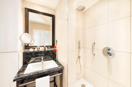A bathroom at The Bailey's Hotel London