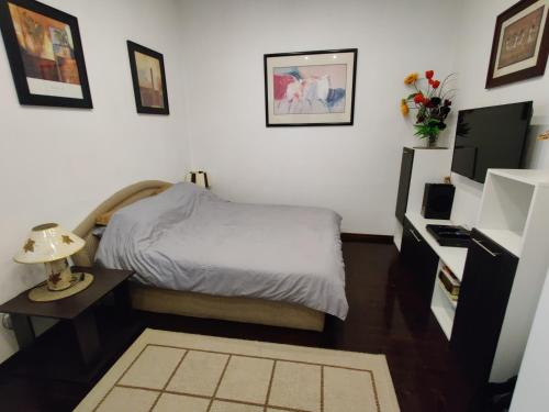 A bed or beds in a room at Slavija Square Apartment Cvetni Trg