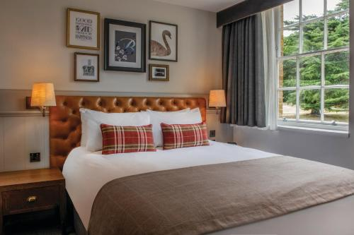 A bed or beds in a room at De Vere Beaumont Estate