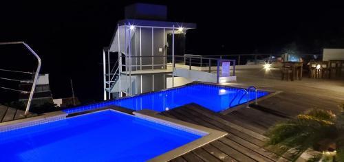 A piscina localizada em Pousada Ilha da Saudade ou nos arredores