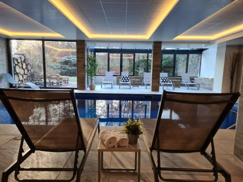The swimming pool at or near Hotel Brasserie JENNY - Spa & Fitness - near Basel