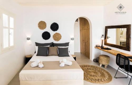 A bed or beds in a room at Astarte Luxury Apartments