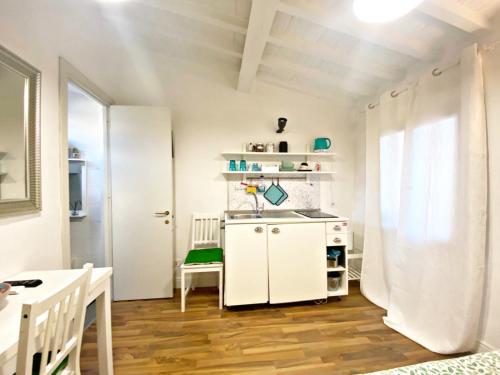A kitchen or kitchenette at Santo Spirito Suite