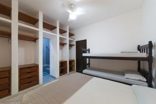 A bunk bed or bunk beds in a room at Búzios Samba Hostel