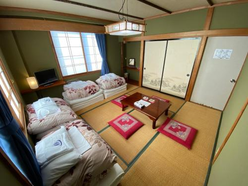 A bunk bed or bunk beds in a room at Nozawa Dream Central