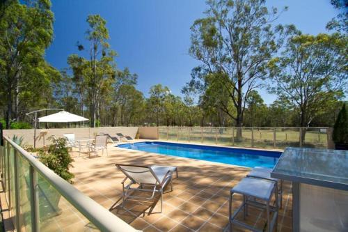 The swimming pool at or near Chez Vous Villas Pokolbin