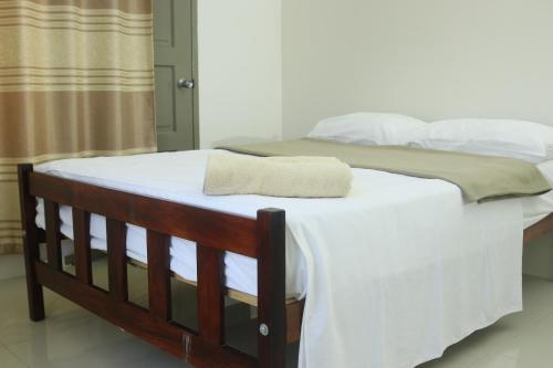 A bed or beds in a room at FIJI HOME Apartment Hotel