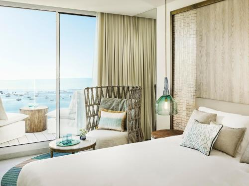 A bed or beds in a room at Nobu Hotel Ibiza Bay