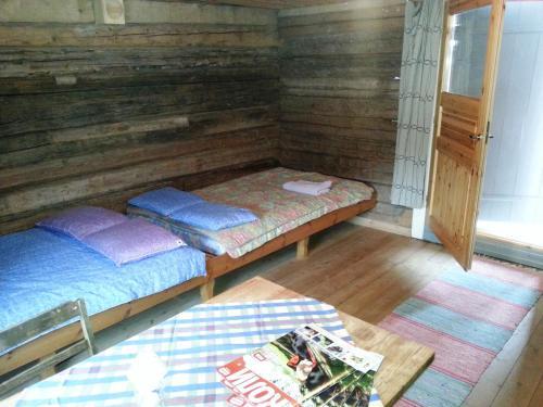 Un ou plusieurs lits dans un hébergement de l'établissement Kolin Ryynänen