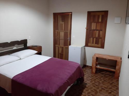 Cama o camas de una habitación en Camping das Aguas