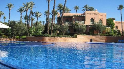 The swimming pool at or near Apartment with 2 bedrooms in Marrakesh with shared pool and enclosed garden