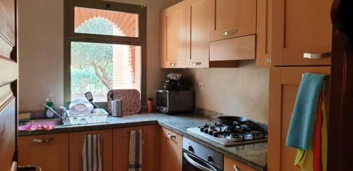 A kitchen or kitchenette at Apartment with 2 bedrooms in Marrakesh with shared pool and enclosed garden