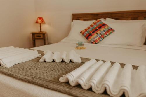 Cama ou camas em um quarto em Pousada Encantos do Peró