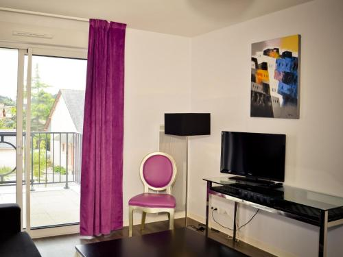A television and/or entertainment center at Apartment Adonis La Baule-1