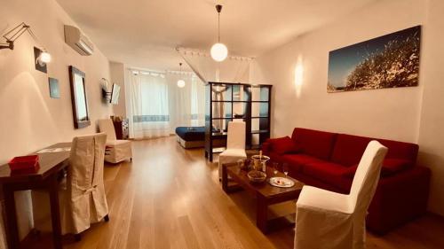 Area soggiorno di Le Suite Sul Corso