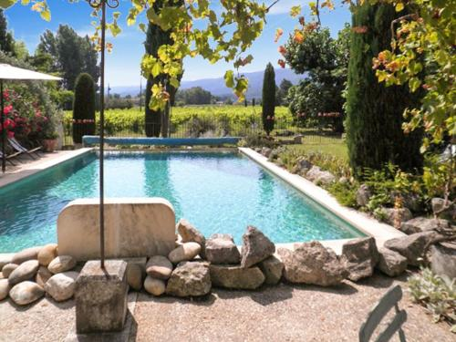 The swimming pool at or near Apartment with 2 bedrooms in Oppede with wonderful mountain view shared pool furnished garden 60 km from the beach