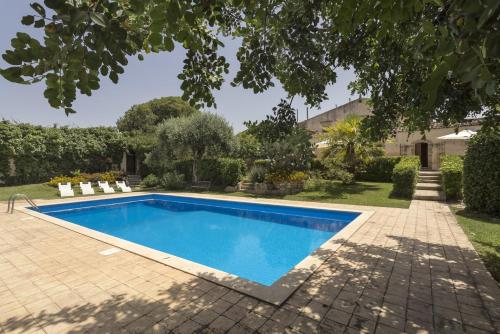 The swimming pool at or near Apartment with one bedroom in Chiaramonte Gulfi with shared pool enclosed garden and WiFi 20 km from the beach