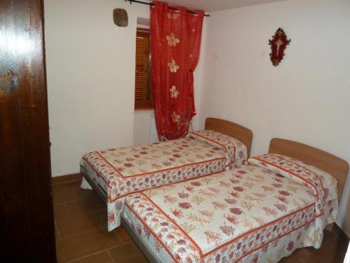A bed or beds in a room at B&B La Locanda di Cecco