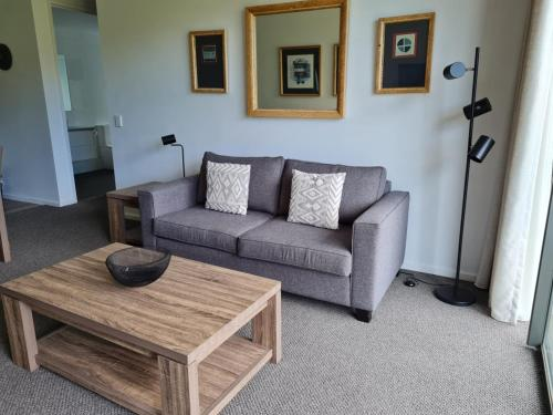 A seating area at Moonah Links - Apartment 43