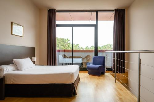 A bed or beds in a room at Aparthotel Wellness
