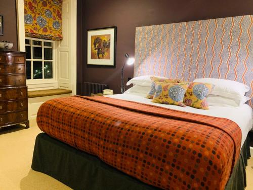 A bed or beds in a room at The Close Hotel