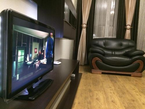 A television and/or entertainment center at Apartment Internatsionalnaya 19а