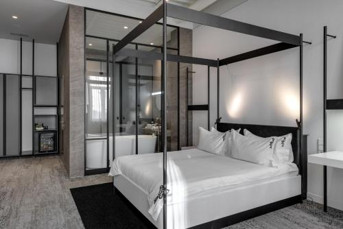 A bed or beds in a room at BURSA Hotel Kyiv