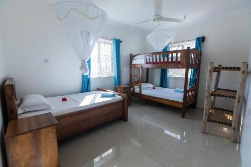 A bunk bed or bunk beds in a room at Kite&Active Guesthouse